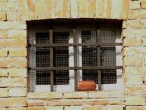 Ventana y barras Fotografía de archivo libre de regalías