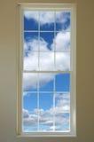 Ventana y nubes Foto de archivo