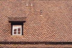 Ventana y tejado del ático Foto de archivo libre de regalías