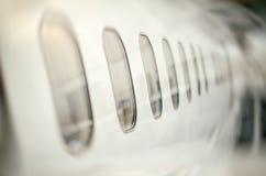 Ventanas de los aviones de pasajero Fotos de archivo libres de regalías