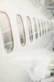 Ventanas de los aviones de pasajero Foto de archivo libre de regalías