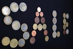 Vente d'inscription, pièces de monnaie présentées Photographie stock libre de droits