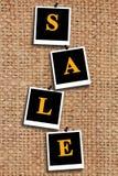 Vente d'inscription sur le tissu renvoyant Photographie stock libre de droits