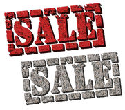 Vente (signes de vente de roche et de brique) Images stock
