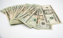 Venti dollari di fatture americani su un fondo bianco Fotografia Stock Libera da Diritti