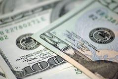 Venti dollari e cento dollari di primo piano Immagini Stock Libere da Diritti