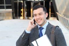 Venti qualcosa uomo d'affari che chiama dal telefono Fotografie Stock Libere da Diritti