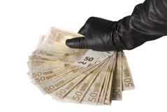 Ventilador de 50 billetes de banco euro en la mano de la mujer Imagen de archivo