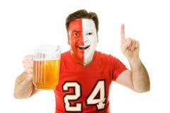 Ventilador de deportes con la cerveza Foto de archivo libre de regalías