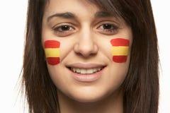 Ventilador de deportes femenino joven con el indicador español Fotografía de archivo