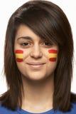 Ventilador de deportes femenino joven con el indicador español pintado Fotografía de archivo libre de regalías