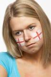 Ventilador de deportes femenino triste con el indicador del St Jorte en cara Imagen de archivo libre de regalías