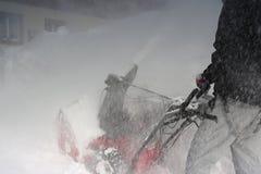 Ventilador de nieve en el trabajo Imagenes de archivo