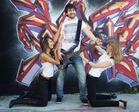 Ventiladores del guitarrista Fotos de archivo libres de regalías