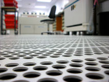 Ventilated floor in a clean room. Ventilated floor with apertures in a clean room Stock Photos