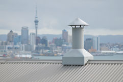 Ventilating duct on roof. Covered with corrugated sheet metal royalty free stock photography