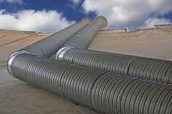 Ventilation. Ventilating pipes against the cloudy sky Stock Image