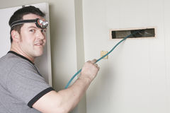 Ventilation cleaner man at work with tool Stock Images