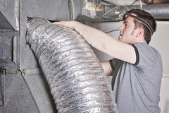 Ventilation cleaner man at work with tool Royalty Free Stock Photos