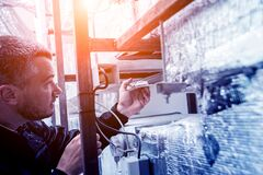 Free Ventilation Cleaning. Specialist At Work. Repair Ventilation System Stock Photos - 173714083
