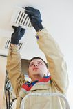 Ventilation engineer worker Stock Image