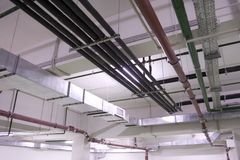 Ventilation engineering services. Ventilation tubes in new elite building Stock Image