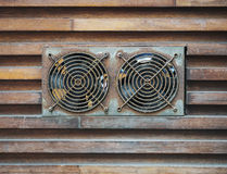 Ventilation fan with old condition and rust in wooden wall backg Stock Image