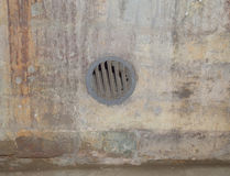 The ventilation grille in the wall. From the round wall grille ventilation Royalty Free Stock Photos