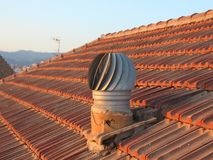 Ventilation Metal Chimney on Shingle Roof with View. Ventilation Metal Chimney on Red Shingle Roof with View Royalty Free Stock Image