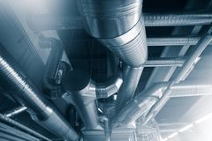 Ventilation pipes ducts of industrial air condition. Ventilation pipes and ducts of industrial air condition Royalty Free Stock Photo