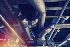 Ventilation pipes and ducts of industrial air condition. At factory Royalty Free Stock Photo