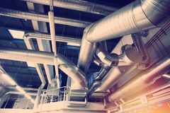 Ventilation pipes and ducts of industrial air condition Stock Photos