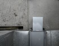 Ventilation shaft on the background of a concrete structure Stock Photo