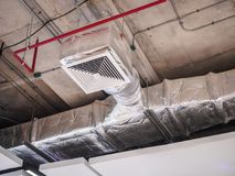 Ceiling air duct in large shopping mall. Ventilation system ceiling air duct in large shopping mall Stock Photography