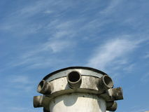 Ventilation tube of a bomb shelter against blue sky Stock Photo