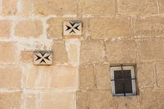 Ventilator on a stone wall. Maltese cross Stock Images