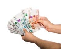 Ventilator van contant geld in de handen Stock Fotografie