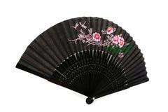Ventilatore cinese nero della mano sopra bianco Fotografie Stock