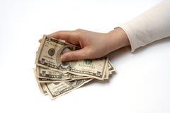 Ventilatore della holding della mano di soldi Fotografie Stock