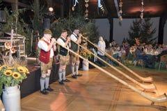 Ventilatori di Alphorn a Oktoberfest Immagine Stock Libera da Diritti