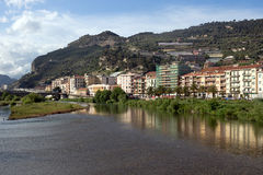 Ventimiglia town along the Roya River, Liguria - Italy. The Roya River divides the town into two parts, one historic and other modern royalty free stock photos