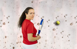 Venting their anger against a wall. Woman vents his anger with a wall with a ball and paddle racket Royalty Free Stock Photo