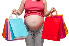 ventre d'un plan rapproché de femme enceinte sur un fond blanc Photographie stock libre de droits
