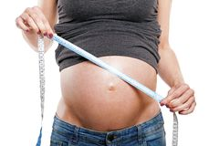 Ventre de mesure femelle enceinte, partie du corps Photographie stock