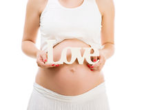 Ventre enceinte avec amour de mot Images stock