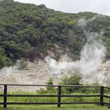 Vents with fence. Smelly stick of rotten eggs of the smell of National park sulphur vents at the La Soufriere Sulphur Spring near the town of La Soufriere in st stock photo