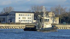 VENTSPILS - DECEMBER 16: Close up of tugboat entering port harbor on December 16, 2016 in Ventspils, Latvia. 4K UHD. VENTSPILS - DECEMBER 16: Close up of stock video footage