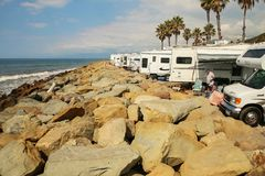 Two men surrounded by several RVs on the rocky beaches of Faria. VENTURA COUNTY, CALIFORNIA, USA - OCTOBER 06, 2006. Two probably retired men enjoy a beautiful Stock Photo