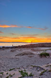 Ventura sunset from beyond the ocean horizon. Royalty Free Stock Image