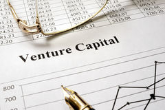Venture capital. Sign venture capital on a paper and glasses Royalty Free Stock Photos